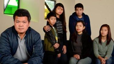 Antonio Enriquez (left) with his family.
