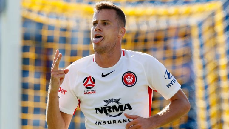 Double trouble: Spanish import Oriol Riera celebrates scoring the Wanderers' second goal in the first half.