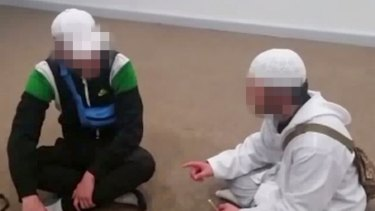 One of the boys, in white, uploaded videos of him converting other young people to Islam.