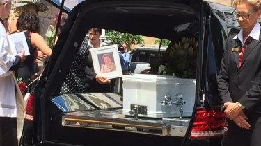 Lloyd's casket leaves her funeral.