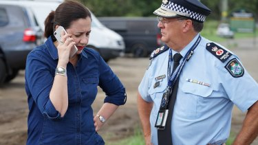 Premier Annastacia Palaszczuk inspecting damage to the John Muntz Bridge on Friday, following the aftermath of wild weather in south-east Queensland.