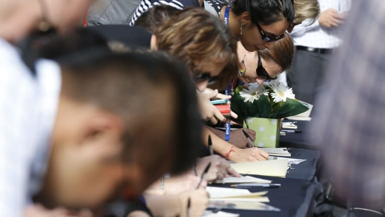 Thousands have left tributes to those killed in the Sydney siege.