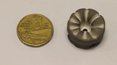 One of the 2.5 centimetre diameter magnesium cathodes (right) from Dr Neumann's ion drive after use.