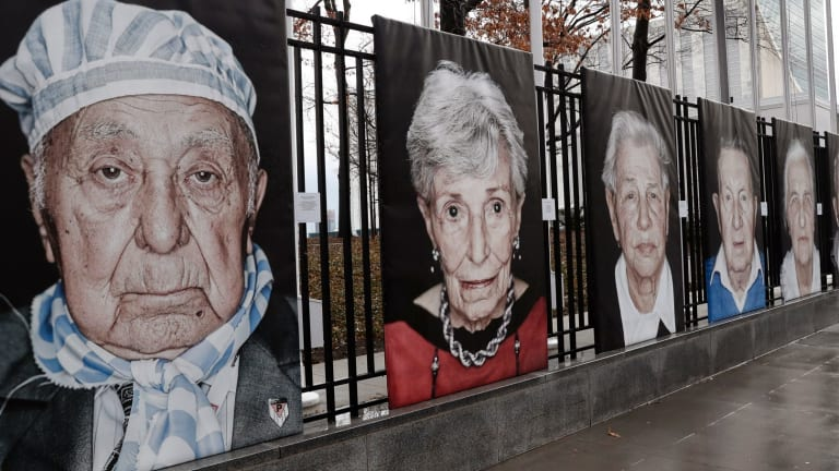 Portraits by Italian photographer Luigi Toscano form a Holocaust remembrance exhibition outside the United Nations headquarters in New York.