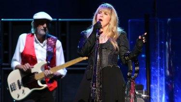 Stevie Nicks and John McVie in the spotlight at Rod Laver Arena.
