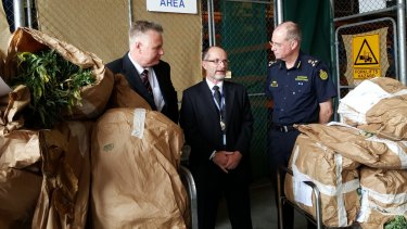 Australian Crime Commission state manager Charlie Carver, Superintendent Mark Slater, and Border Force Queensland Commander Terry Price with some of the drug haul on Wednesday.