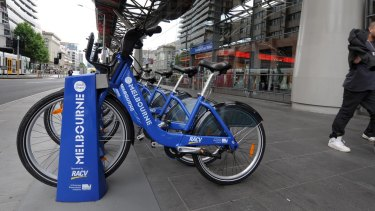 Melbourne Bike Share bikes, a council and RACV initiative, line up outside Southern Cross station.
