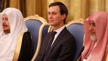 Jared Kushner watches as Donald Trump is presented with The Collar of Abdulaziz Al Saud Medal, at the Royal Court Palace, in Riyadh.