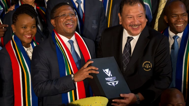 Happier times: South Africa's Minister of Sport and Recreation Fikile Mbalula (centre) holds Durban's 2022 Commonwealth Games bid book in 2015.