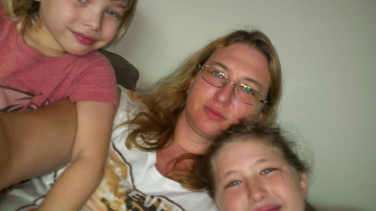 Yoshe Ann Taylor with her children, Archer (left) and Kahlyla, in Australia before her arrest in 2013.