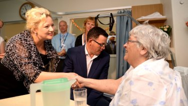 Victorian Premier Daniel Andrews and Health Minister Jill Hennessey chat with patient June Maher at Frankston hospital during a tour in December 2014.