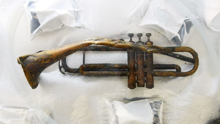 A broken trumpet from a sunken warship holds its secrets from WWII.