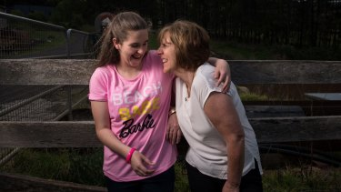 Jordanne Taylor, pictured in September with her mother Debra in Kurrajong Hills, has autism spectrum disorder and receives support from the NDIS.