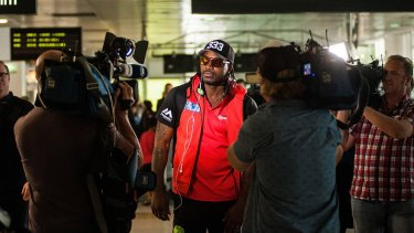Chris Gayle faces the media at Melbourne's Tullamarine Airport.
