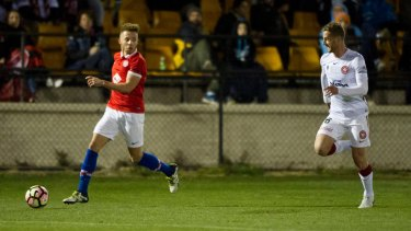 Canberra FC's Thomas James sets up a cross against the Wanderers on Wednesday night.