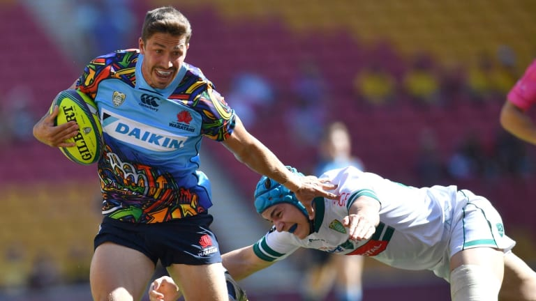 Last gasp: Jake Gordon fends off a desperate tackle.