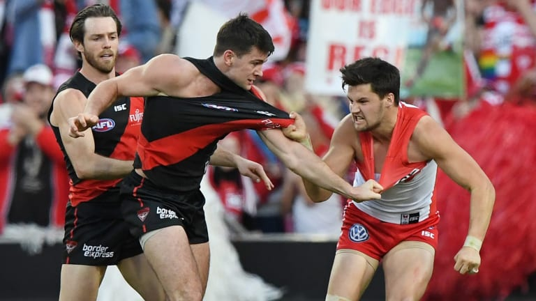 Conor McKenna of the Bombers (centre) tangles with Sydney's Nic Newman.