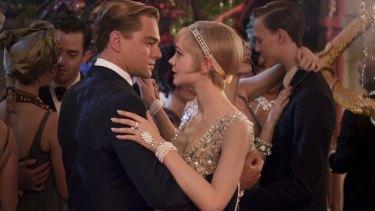 Leonardo DiCaprio as the ultra wealthy Jay Gatsby and Carey Mulligan as Daisy Buchanan in <i>The Great Gatsby</i>.