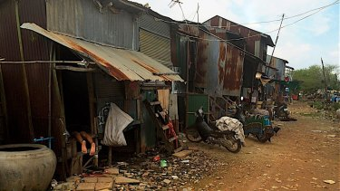 The Cambodian village of Khmounh is effectively a squatter settlement. Some of the women work in garment factories earning $US128 per month for a six-day working week.