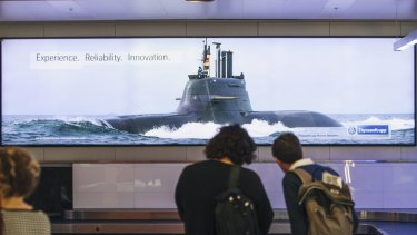 An advertising poster featuring a submarine at Canberra Airport.