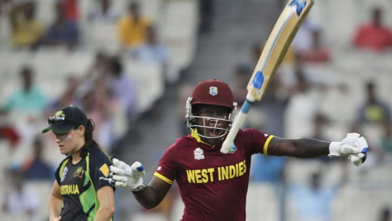 Deandra Dottin throws the bat skyward after the West Indies won the T20 World Cup.