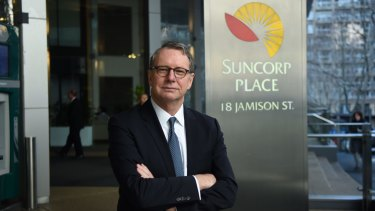 Suncorp managing director Michael Cameron concedes climate change is happening, but has not clarified if he believes it is caused by humans.