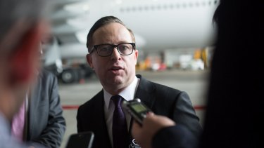 Qantas CEO Alan Joyce. The airline has disclosed softer trading conditions for the December half.