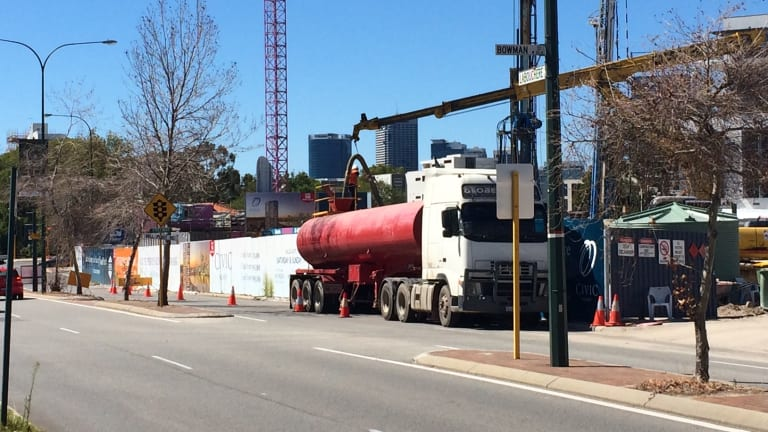 Dewatering trucks are now a regular feature of the busy stretch of road.