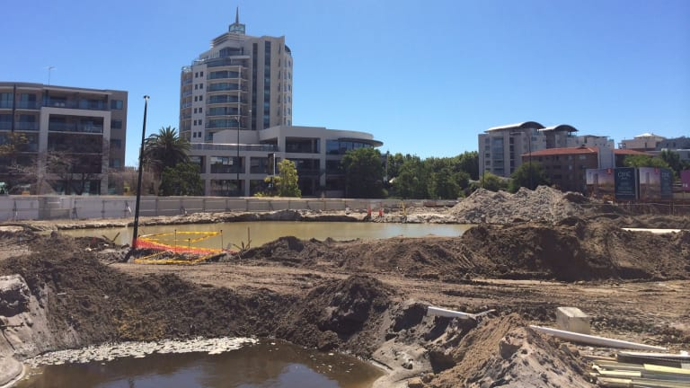 """Perth's new lakes district? Excess water from the Aurelia site is being pumped here to the site across the road, but the City of South Perth says it is the """"apparent"""" cause of flooding at the neighbouring apartment block."""