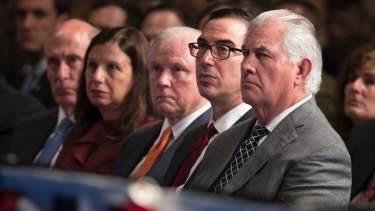 From right, Secretary of State Rex Tillerson, Treasury Secretary Steven Mnuchin, and Attorney-General Jeff Sessions listen to to Donald Trump as he speaks at Fort Myer.