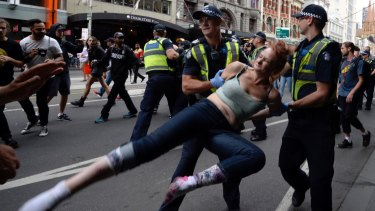 Two people were arrested as police moved to remove the homeless people from Flinders Street.