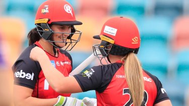 Emma Inglis and Sophie Molineux celebrate victory.
