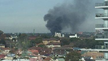 Smoke billows from a factory fire in Auburn.