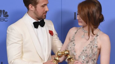 Ryan Gosling and Emma Stone after winning Golden Globes for <i>La La Land</i>, which received 14 Oscar nominations.