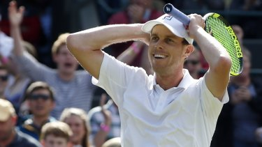 Sam Querrey of the US celebrates after beating Djokovic.