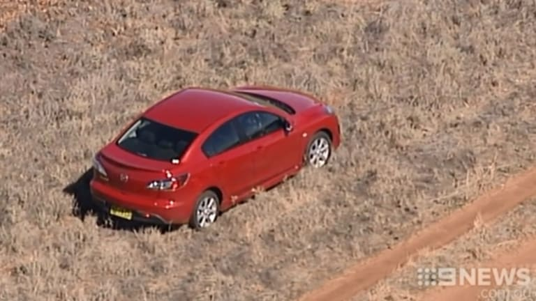 Stephanie Scott's car on the side of the road in a wheat field about eight kilometres from Leeton.