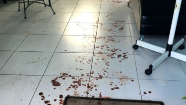 Blood on the floor of the Minto hair salon.