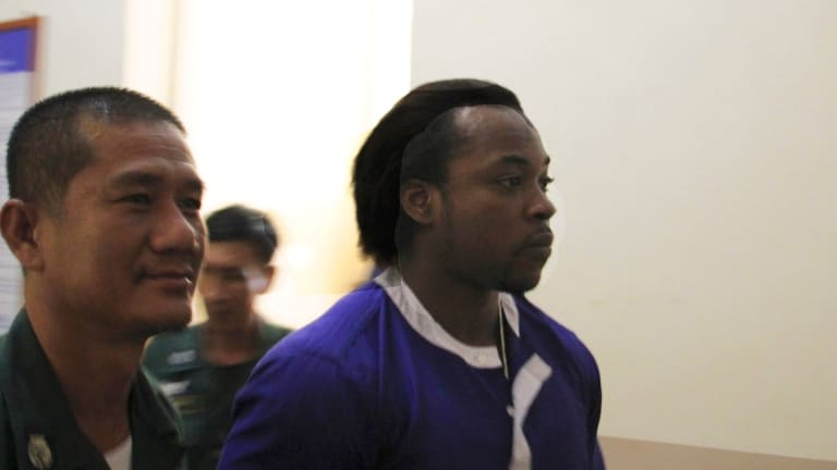 Nigerian Precious Chineme Nwoko, right, at the Cambodian Appeals Court on Tuesday after being refused permission to appeal against his 27-year prison sentence for heroin smuggling.