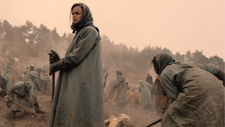 Ofglen/Emily (Alexis Bledel) ponders the short and brutal life of a worker in the Colonies.
