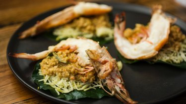King prawn on betel leaf with prawn and coconut curry.