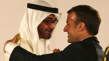 French President Emmanuel Macron is welcomed by the Crown Prince of Abu Dhabi Mohammed bin Zayed al-Nahayan to the Louvre Abu Dhabi Museum on Wednesday.