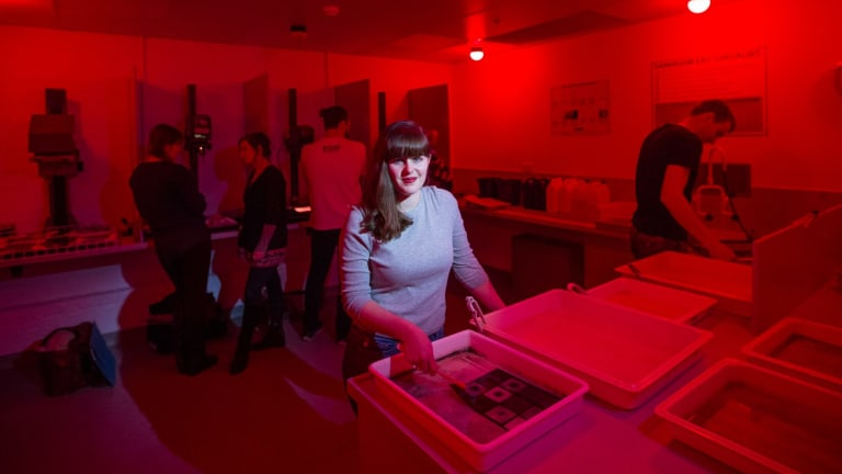 Students working in the recently opened darkroom at Deakin University's Waterfront campus in Geelong.