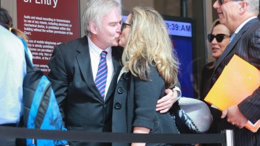 Kathy Jackson, and her partner Michael Lawler, arrive at the Melbourne Magistrates Court on Monday.