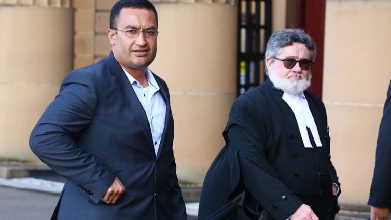 Free man: Brian Brown leaves court with barrister Winston Terracini.