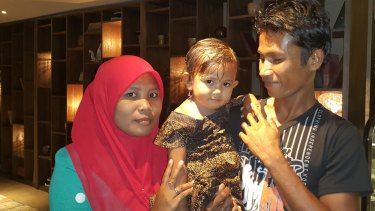 Ali Jasmin with his wife Baualan and his 18-month-old daughter Aisah Nuruna.