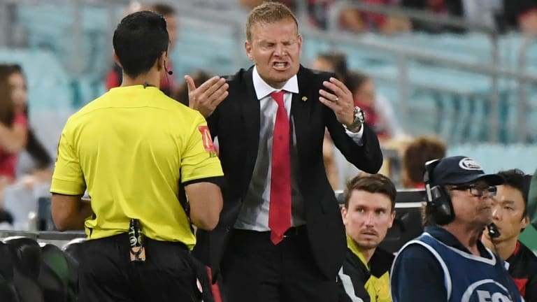 Point of dispute: Wanderers coach Josep Gombau argues with the fourth official.