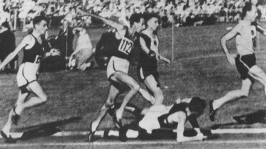 The moment in 1956: John Landy jumps over a fallen Ron Clarke at Olympic Park. He stopped to check that Clarke was OK.