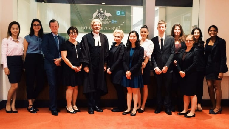 Barrister Alan Hands (centre) and Faye Gertner (left of Hands) the director of Monash Oakleigh Legal Service, with students who worked on the High Court application for murderer John Glascott.