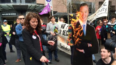 Chloe Rafferty, NSW education officer for the National Union of Students, lights an effigy of Education Minister Christopher Pyne.