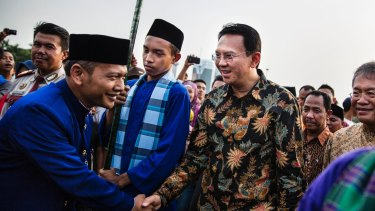 Ahok, right, greets people in Jakarta in 2014. A Christian and ethnic Chinese, he became governor after his predecessor and political ally Joko Widodo was elected president of Indonesia.